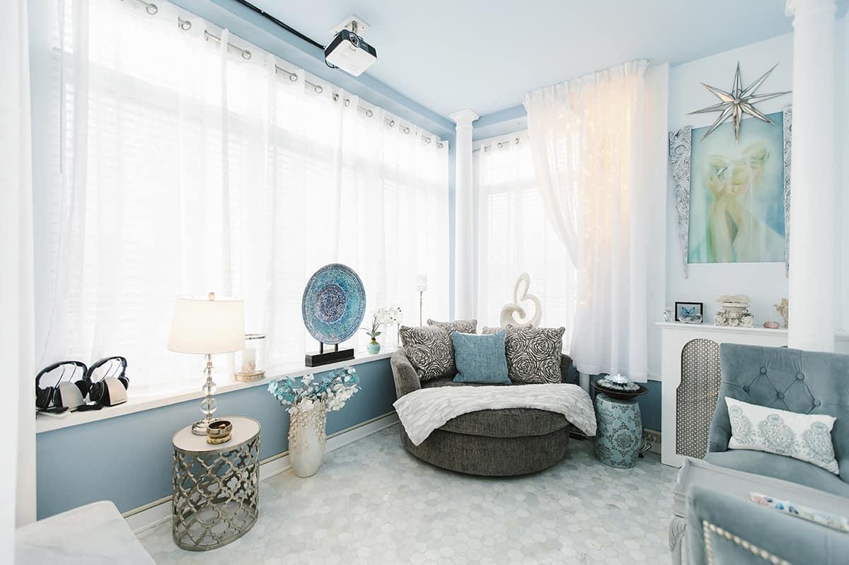 meditation room with big windows and comfortable seating