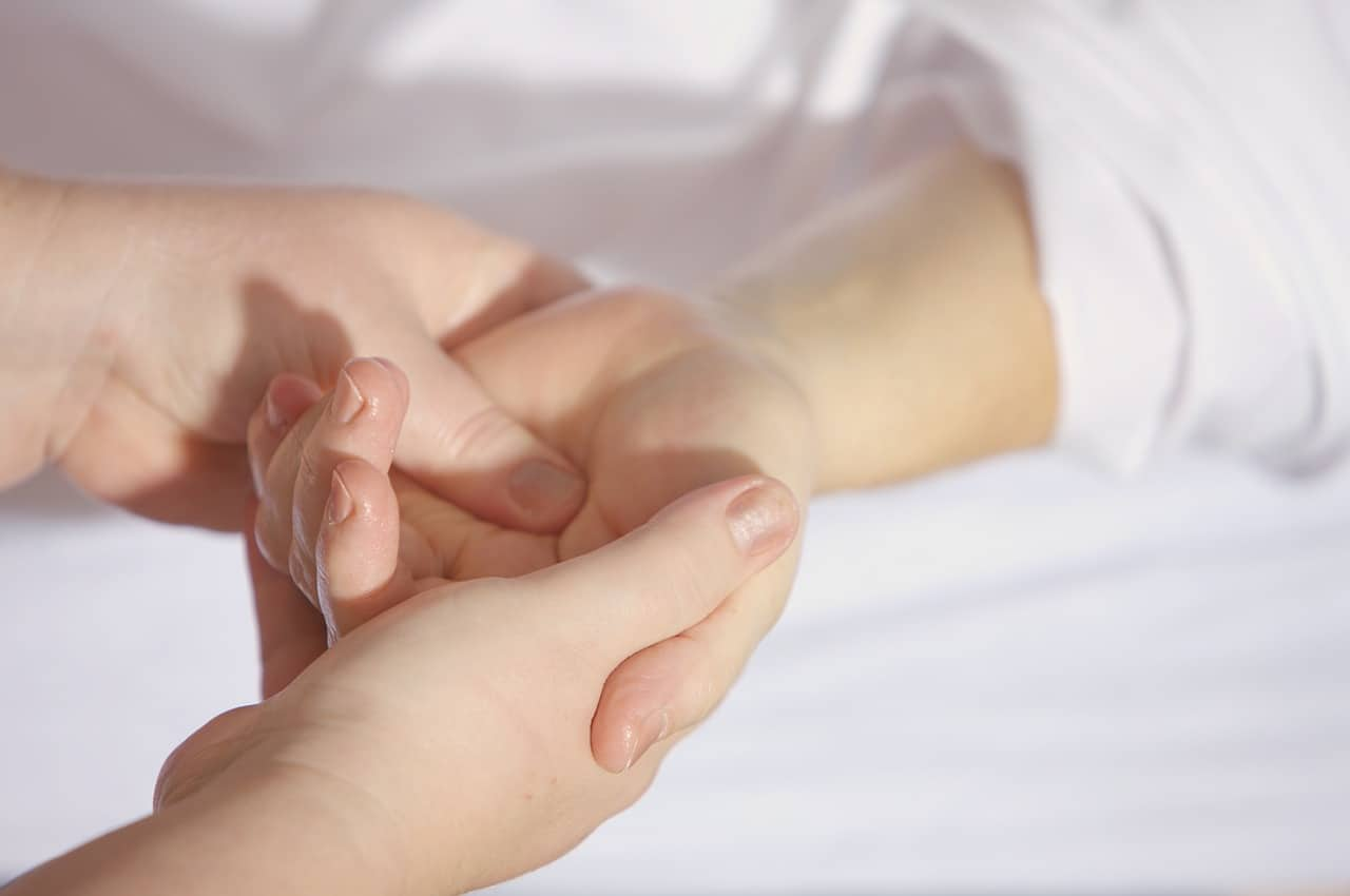 someone receiving a hand massage