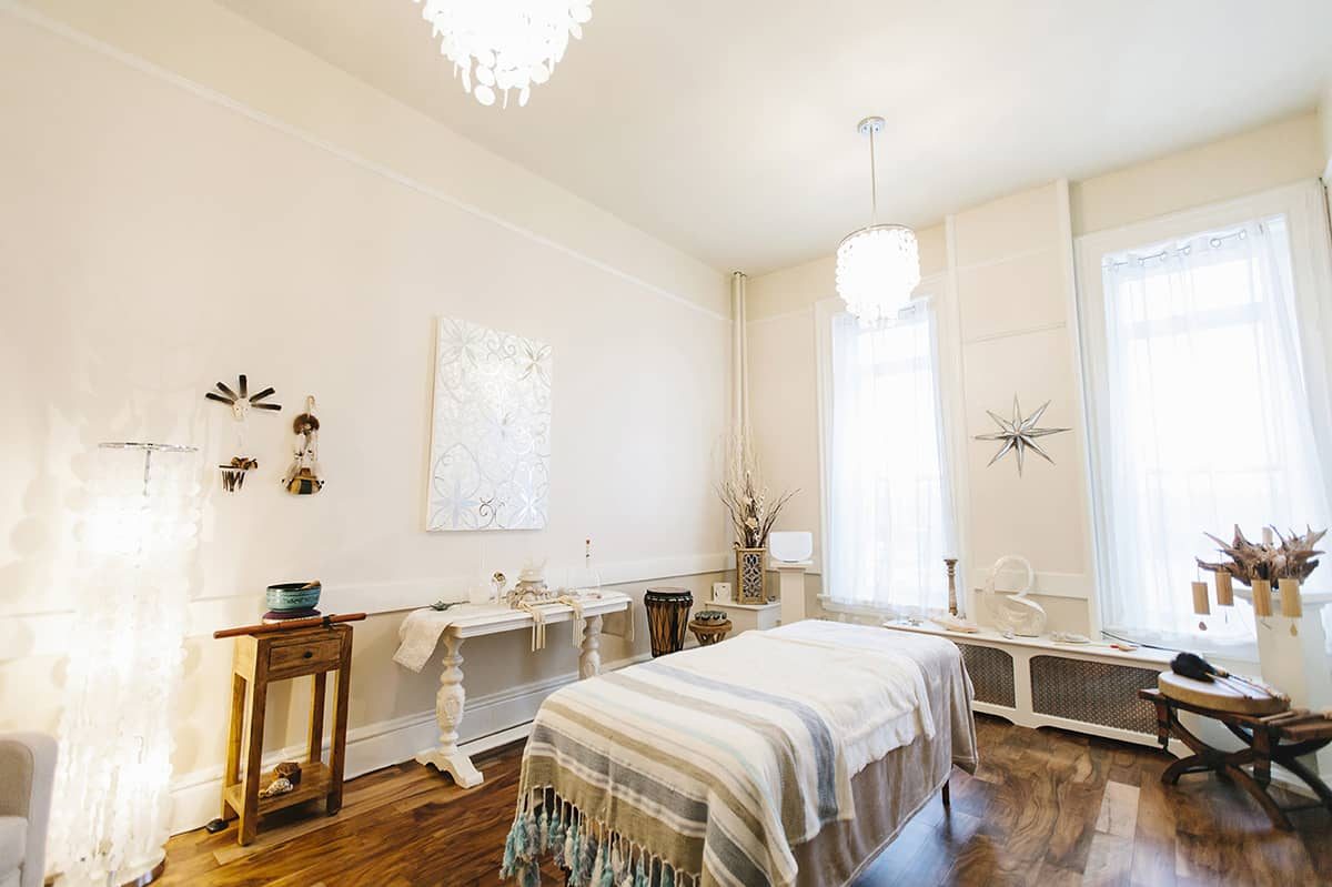 sound healing room with comfortable bed and decor