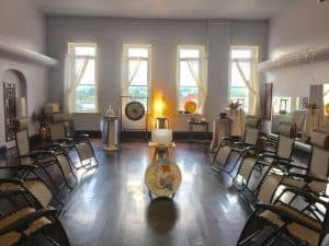 view of the sound healing room with chairs set up